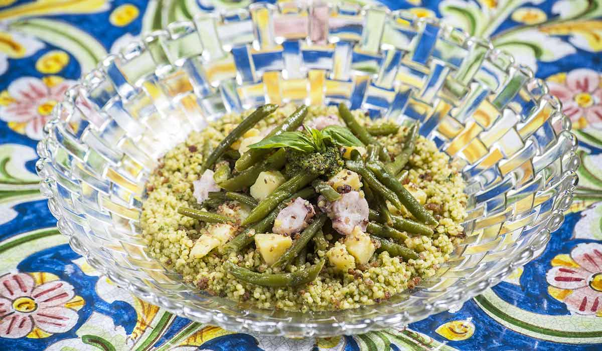 A modern update of the traditional couscous dish with Octopus, basil pesto and olives