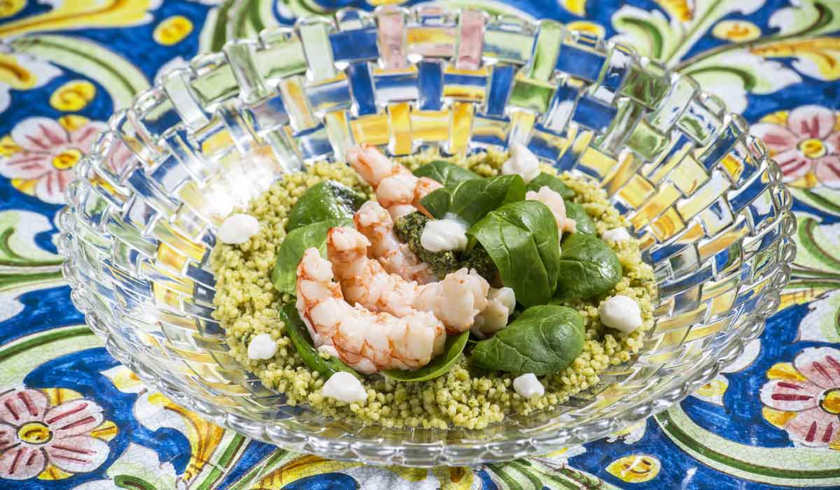 This recipe combines pesto and couscous, two elements from traditional Ligurian and Sicilian cuisine