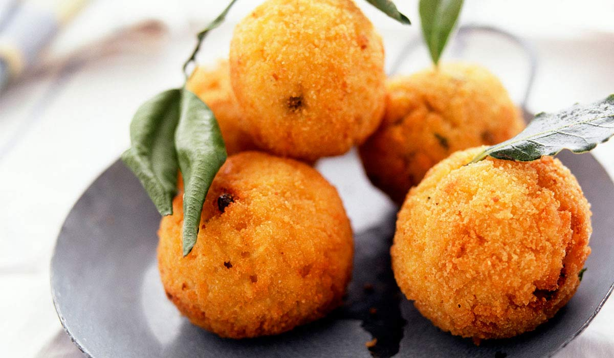 fried rice, meat and cheese balls appetizer - arancini di riso