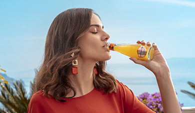 girl enjoying sanpellegrino organic aranciata