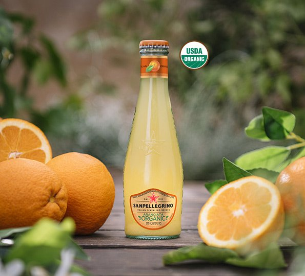 Cut oranges with Sanpellegrino organic aranciata