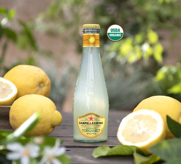 Cut lemons and Sanpellegrino limonata organic drink