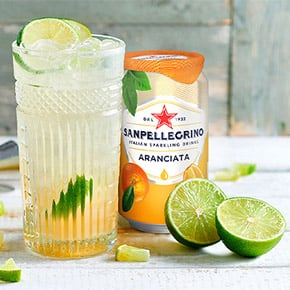 A glass with lime and Sanpellegrino Aranciata