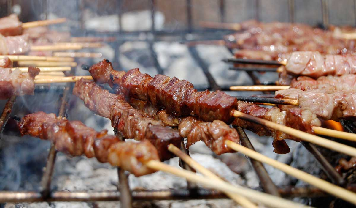 arrosticini sheep meat skewers on the barbecue