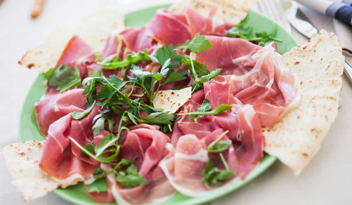 Piadina with prosciutto, Squacquerone and aragula