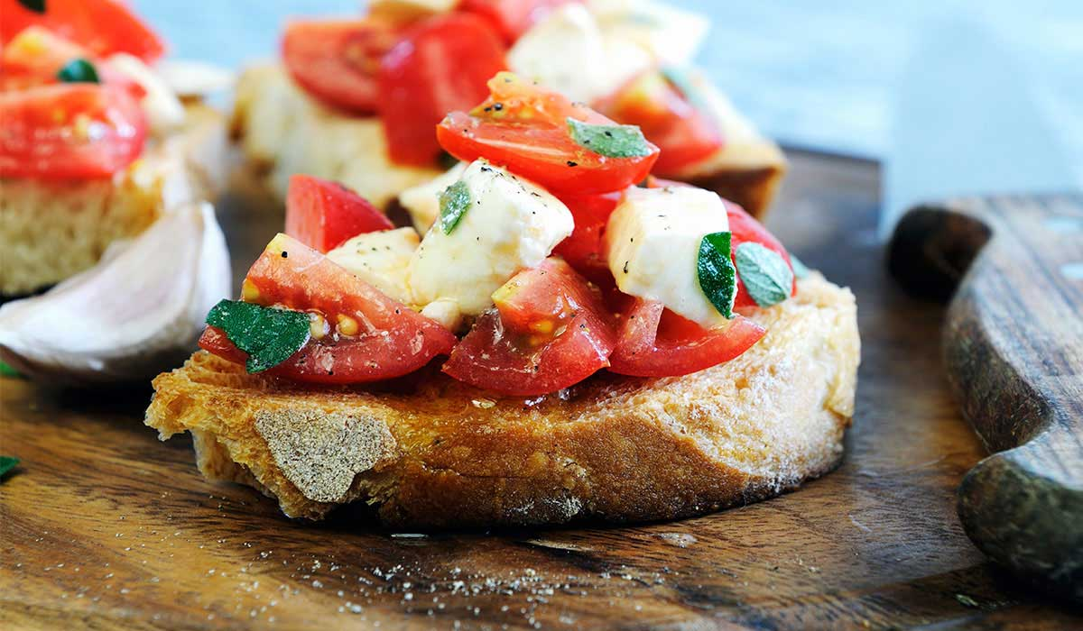 Bruschetta with ripen tomatoes and mozzarella recipe