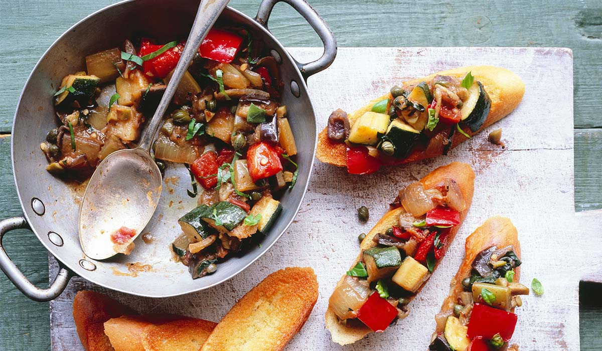 Pan of Caponata with bread on the side